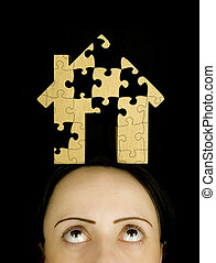 woman with a puzzle to solve - woman with a jigsaw puzzle to...