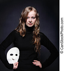 Low key portrait of a beautiful girl with mask