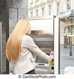 Woman use Bank ATM