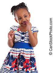Portrait of a cute little african american girl with a lollipop