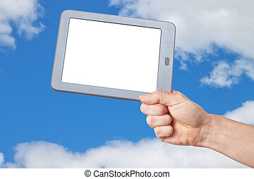 Tablet with a clean screen in his hand against the sky.