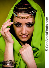 woman in color arabian clothes - Beautiful young woman in...