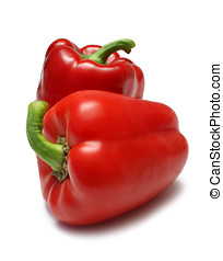 Capsicum - Two Red Capsicum Bell Peppers isolated on white