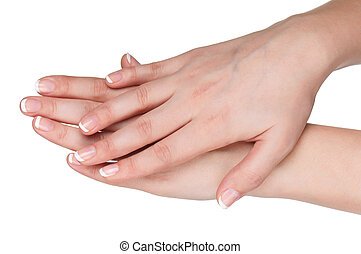Woman hands with french manicure isolated on white...