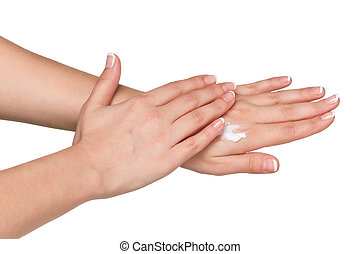 Woman hands with french manicure applying hand cream...