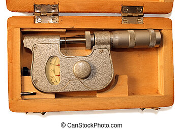 old micrometer in wooden box isolated