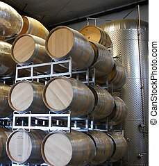 Wine Barrels and Vat - Winery new barrels stacked next to...