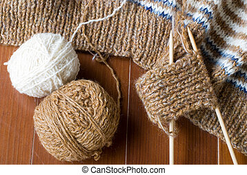 Knitting yarn and knit - Two knitting yarns and the middle...