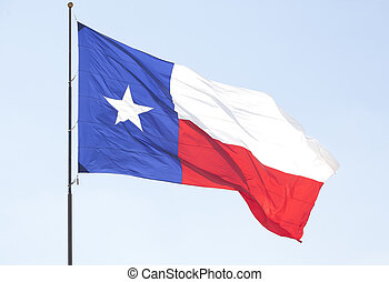 Texas Lone Star flag pole flying over the blue sky