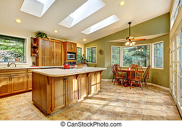 Large country kitchen with skylights - Large green country...