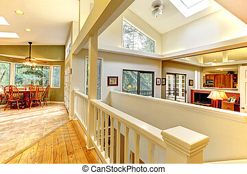 Large bright home interior with hallway.