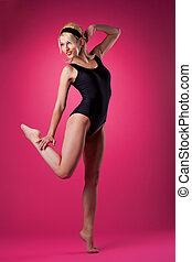 Young sport woman dance in pin-up style black suit