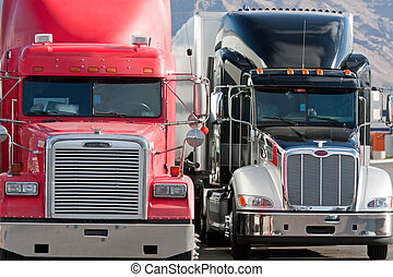 2 two trucks truck fleet - trucks in a row next to each...