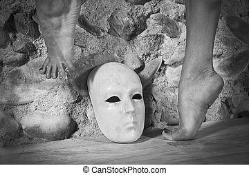 Feet dancing above a white mask. - Fine art photo of female...