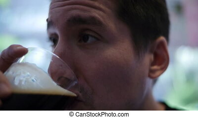 Man Drinks Beer 2 - A man takes two sips of a refreshing...