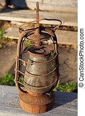 The old kerosene lamp - Antique kerosene lamp on the...