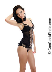 Seductive young woman in black lingerie. Isolated on white.
