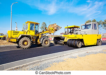 Road under construction - Wheel loader machine, pneumatic...