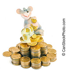 The rich mouse - The mouse sits on a pyramid from money...