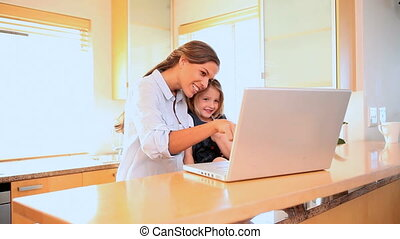 A mother and daughter in a video call on the laptop