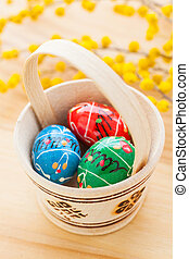Basket with Easter eggs - Basket with colored Easter eggs...