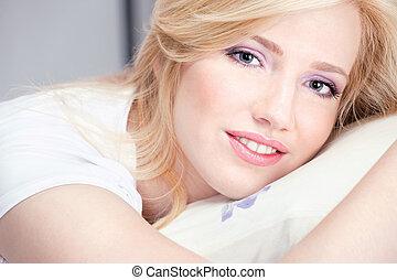 Pretty woman on pillow