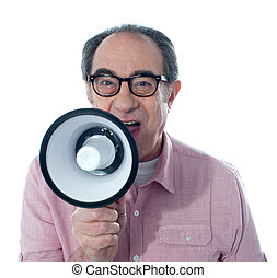 Excited old man making an announcement through megaphone,...