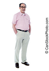 Joyful senior man posing casually with hands in pocket...