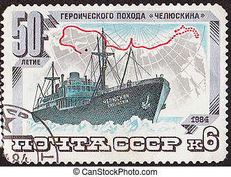 "USSR - CIRCA 1984: A stamp printed in the USSR shows  ship with inscription (in Russian) ""50th Anniversary of the heroic ?ampaign of Chelyuskin"".Circa 1984"