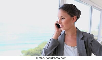 Video of a businesswoman on the phone