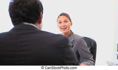 Business people shaking hands after a meeting in a bright...