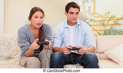 Friends playing a video game in the living room