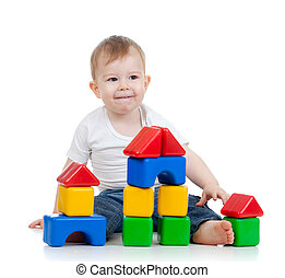 cute little child playing with building blocks isolated on white