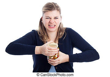 Woman struggling to open bottle - Young woman struggling to...
