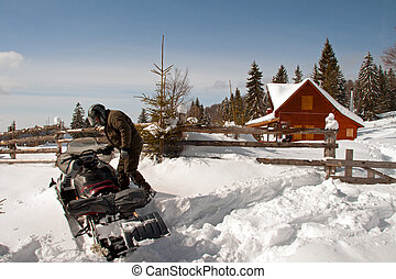 Man with a snowmobile