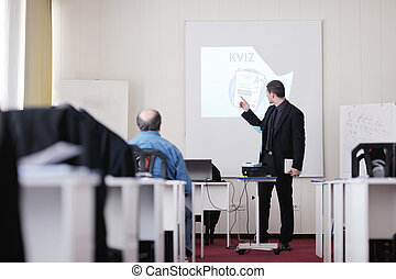 business man on seminar - young business man giving...