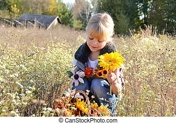 Little girl in field - Little blond girl with autumn flowers...