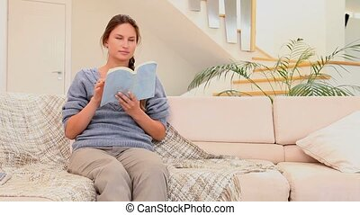 Man announcing a good news to his wife in the living room