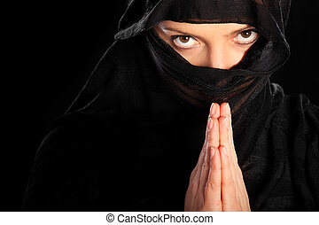 Praying muslim - A picture of a young arabic woman focused...