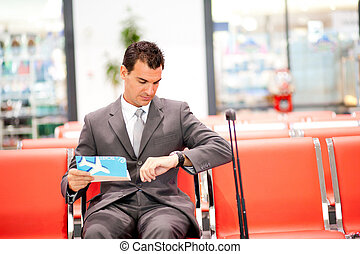 young businessman waiting his fight at airport
