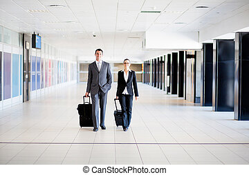 business travelers walking in airport - two business...
