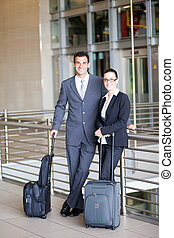 two young business travelers at airport