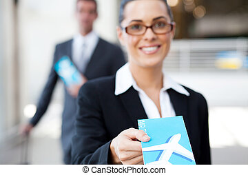 businesswoman at check in counter - businesswoman handing...