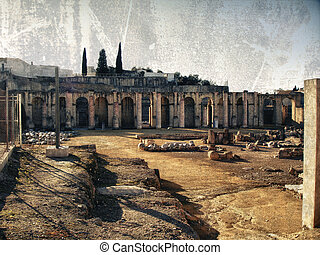 Roman amphitheater of Italica in Sevilla, grunge backround...