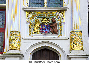 historical architecture detail with blazon in Brugge Belgium