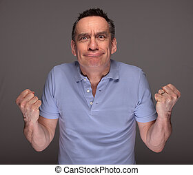 Angry Man Pulling Face and Shaking Fists - Angry Middle Age...