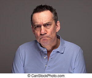 Man Pulling Grimace Face and Glaring - Handsome Middle Age...