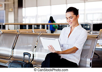 businesswoman using tablet at airport