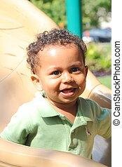 smiling biracial boy - young biracial child smiling