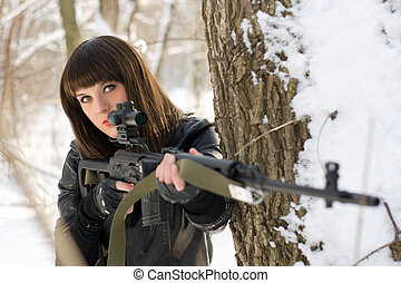 young lady with a sniper rifle - Portrait of gorgeous young...